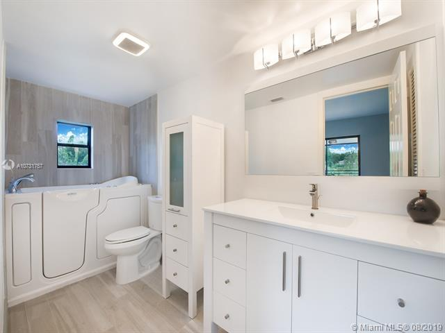 En-Suite Bath for Secondary Bedroom. Features a Walk-in Tub for Ease of Entry.