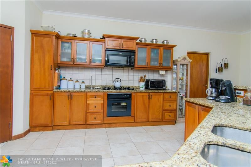 This large kitchen is made to entertain; you could even dance here