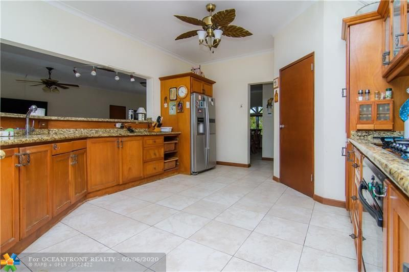 Ample counter space and kitchen cabinets in this kitchen