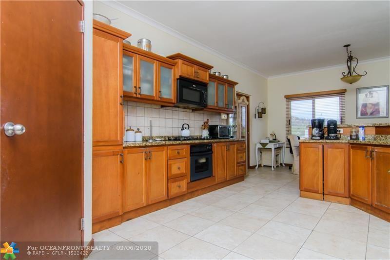 Ample kitchen with plenty of counter space, walk in pantry and kitchen cabinets
