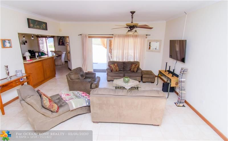 Family/living room with patio view and easy access to the kitchen